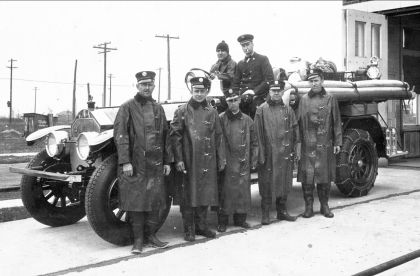 Village of Center Line, Michigan Volunteer Fire Department members shown in front of their 1926 American La France Pumper