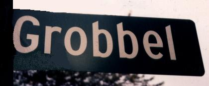 Street sign at the corner of 12 Mile Rd. and Grobbel Drive